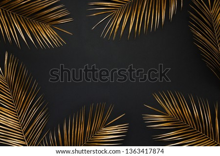 Golden painted date palm leaves creative border frame on dark black background isolated. Empty space, room for text. Minimalist style luxury wedding banner, invitation card template.