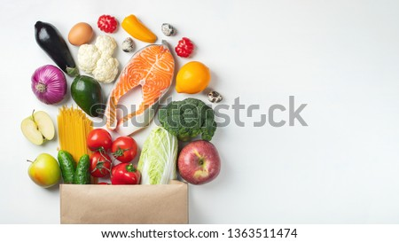Supermarket. Paper bag full of healthy food. With copy space. #1363511474