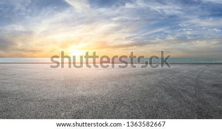 Asphalt race track ground and river with beautiful clouds at sunset #1363582667