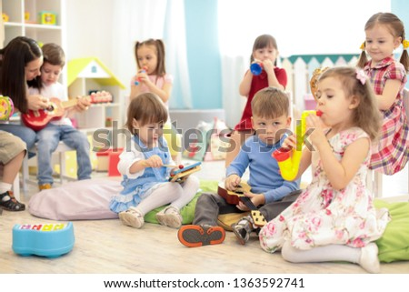Teacher and kids group during music lesson in preschool #1363592741