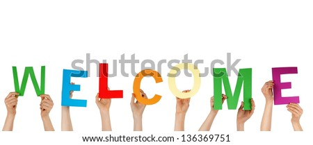 many hands holding the letters building WELCOME, isolated