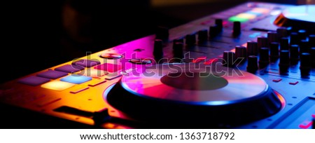 DJ controller close up view in live performance night club dance music Royalty-Free Stock Photo #1363718792