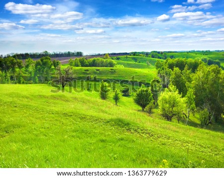 Picturesque hilly landscape with bright blue cloudy sky. Cherkasy region of Ukraine #1363779629