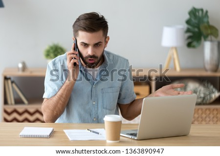 Outraged unhappy businessman talking on phone, unpleasant conversation with client, customer, angry man arguing, making call, customer disputing or complaining with support service #1363890947