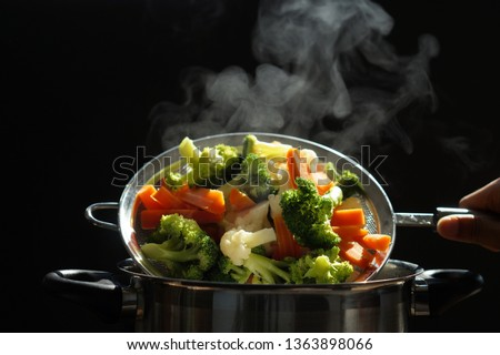steaming of hot boiled vegetables. Basket of vegetables that just boiled from hot water with steam selective focus, soft focus. hot food, diet and  healthy concept. #1363898066