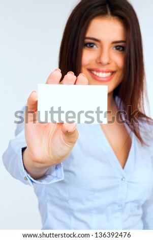 Businesswoman holding a blank card with a smile