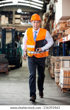 Portrait of young supervisor in a hurry at warehouse #136393463
