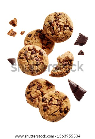 Broken chocolate chip cookies. Cookies broken in pieces with crumbs.  #1363955504