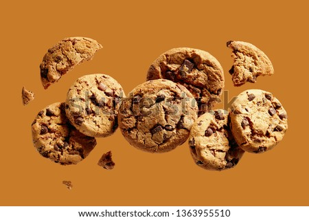 Broken chocolate chip cookies. Cookies broken in pieces with crumbs.  #1363955510
