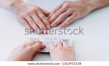 Financial support. Woman offers man money loan in cash. Business sponsorship and patronage. #1363955528