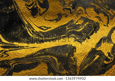 Golden swirl, artistic design. Suminagashi – the ancient art of Japanese marbling. Paper marbling is a method of aqueous surface design. Black and gold paper texture.  #1363974902