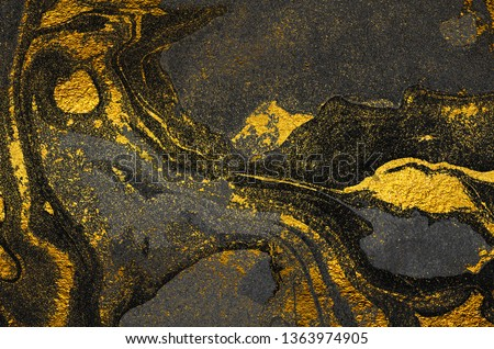 Golden swirl, artistic design. Suminagashi – the ancient art of Japanese marbling. Paper marbling is a method of aqueous surface design. Black and gold paper texture.  #1363974905