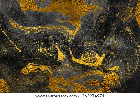 Golden swirl, artistic design. Suminagashi – the ancient art of Japanese marbling. Paper marbling is a method of aqueous surface design. Black and gold paper texture.  #1363974971