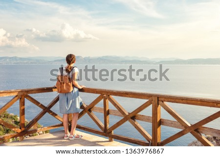 .Young beautiful girl traveling along the coast of the Mediterranean Sea. #1363976867