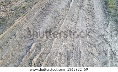 Skid Marks in Dirt Royalty-Free Stock Photo #1363982459