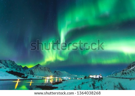 Northern lights at night against the backdrop of beautiful mountains by the ocean at a time of winter in Norway in the Lofoten Islands #1364038268