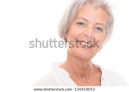 Smiling senior woman in front of white background #136418012