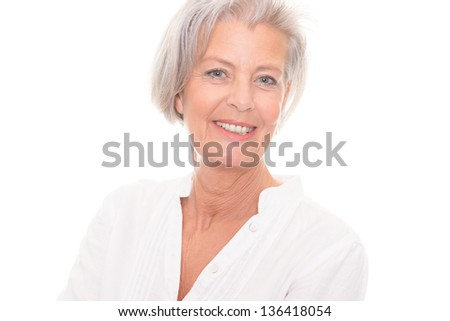 Smiling senior woman in front of white background #136418054