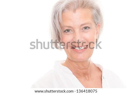 Smiling senior woman in front of white background #136418075