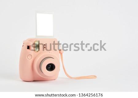Instant camera on white #1364256176