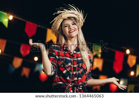 Brazilian woman wearing typical clothes for the Festa Junina - June festival #1364465063