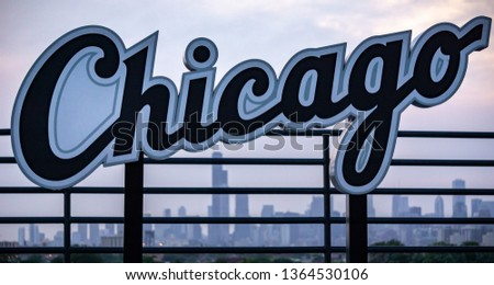 Chicago Sign with the Chicago Skyline in the Backdrop