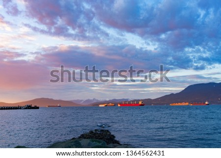 freighters stop at the bay of vancouver at sunset. #1364562431