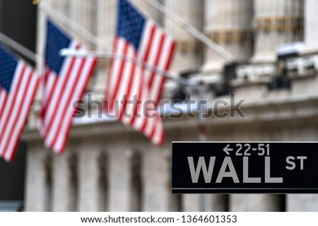 Wall street sign with New York Stock Exchange background New York City, New York, USA. #1364601353