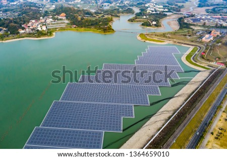 The Kaohsiung Reservoir in Taiwan, Asia, uses the vast space above the water to carry out environmentally-friendly green energy solar power generation. #1364659010