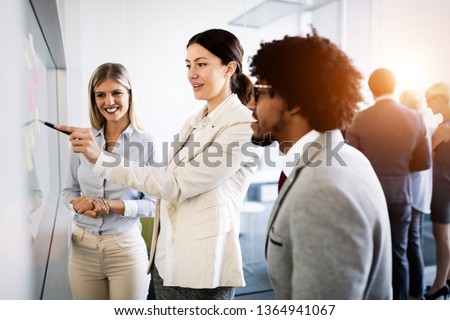 Businesspeople discussing together in conference room during meeting at office #1364941067