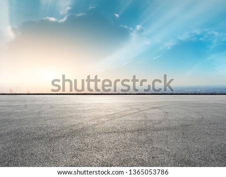 Shanghai city skyline and asphalt race track ground at sunrise,high angle view #1365053786