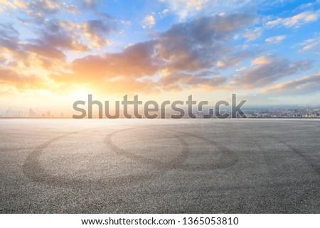 Shanghai city skyline and asphalt race track ground at sunrise,high angle view #1365053810
