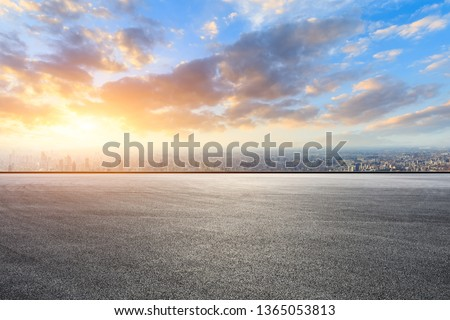 Shanghai city skyline and asphalt race track ground at sunrise,high angle view Royalty-Free Stock Photo #1365053813