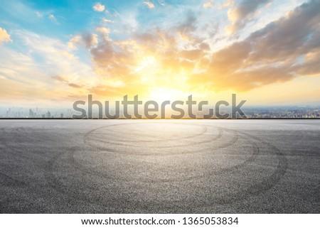 Shanghai city skyline and asphalt race track ground at sunrise,high angle view #1365053834