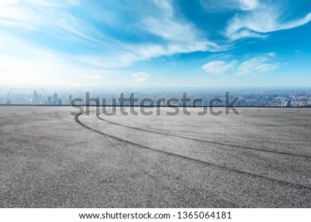 Shanghai city skyline and asphalt race track ground scenery,high angle view #1365064181