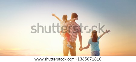 Happy loving family. Father and his daughters children playing and hugging outdoors. Cute little girls and daddy.  #1365071810