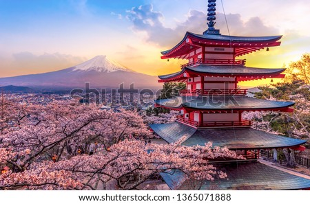 Fujiyoshida, Japan Beautiful view of mountain Fuji and Chureito pagoda at sunset, japan in the spring with cherry blossoms #1365071888