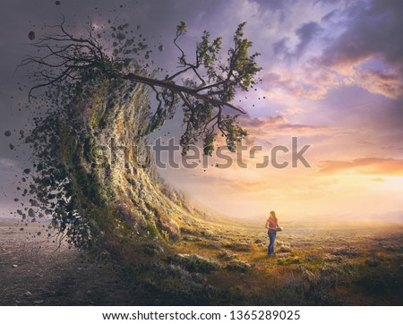 A landscape turns into a crashing wave as a woman looks on. Royalty-Free Stock Photo #1365289025