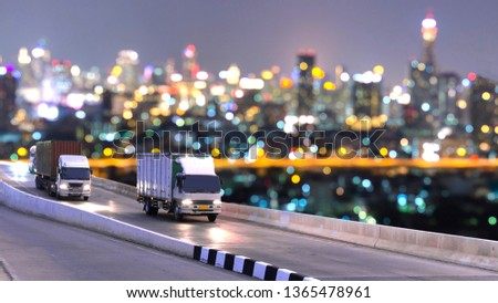 Truck on highway road with container, transportation concept.,import,export logistic industrial Transporting Land transport on the asphalt expressway with night light blurred #1365478961