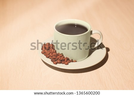 A cup of coffe with coffee beans #1365600200
