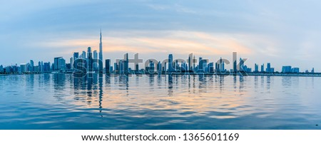 Dubai Skyline under Cloudy Sky, Dubai Downtown Residential and Business Skyscrapers, a view from Dubai Water Canal, Dubai, United Arab Emirates Royalty-Free Stock Photo #1365601169