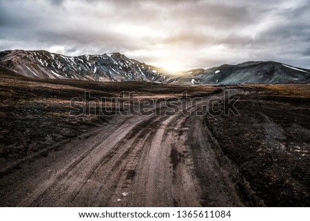 Beautiful Landmanalaugar gravel dust road way on highland of Iceland, Europe. Muddy tough terrain for extreme 4WD 4x4 vehicle. Landmanalaugar landscape is famous for nature trekking and hiking. #1365611084