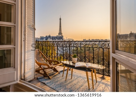 paris balcony with splendid view on eiffel tower at sunset Royalty-Free Stock Photo #1365619916