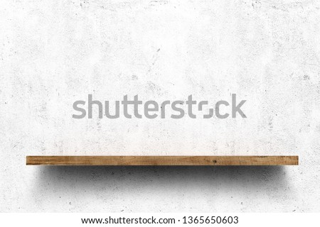 Wooden shelf over white concrete wall background Royalty-Free Stock Photo #1365650603