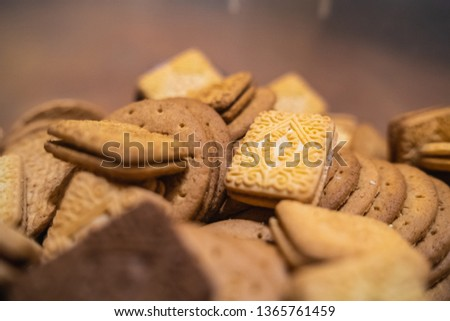 assorted platter mountain of mixed biscuits, digestive custard cream bourbon pink filling chocolate Royalty-Free Stock Photo #1365761459