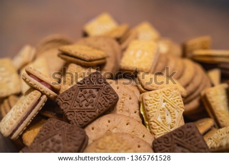 assorted platter mountain of mixed biscuits, digestive custard cream bourbon pink filling chocolate Royalty-Free Stock Photo #1365761528