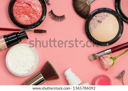 Set for professional makeup, different brushes for applying powder and eyeshadow. Cosmetics and Foundation, concept on pink background #1365786092