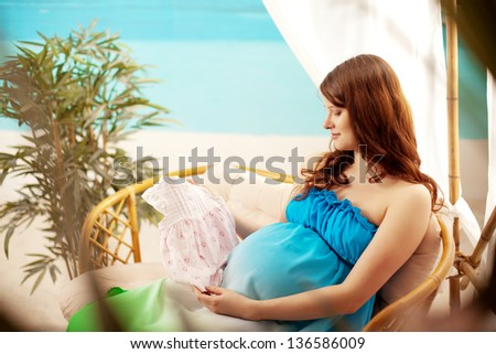 Beautiful pregnant woman on the beach in bungalow #136586009