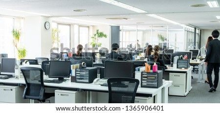 Working businessperson in office. #1365906401