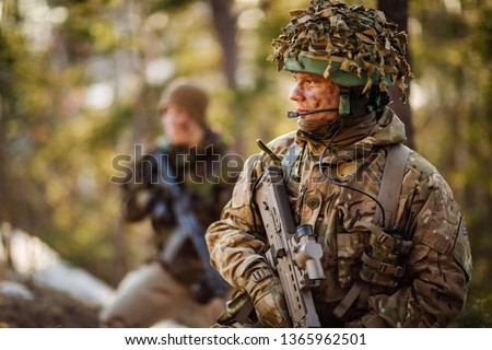 British special forces soldier with weapon take part in military maneuver. war, army, technology and people concept. #1365962501